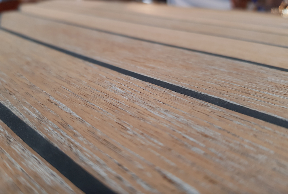 The surface of the new teak deck. Radial cutting of wood. Selective focus