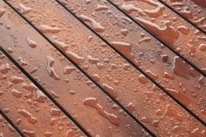 Splashes of Rain on a Stained Deck